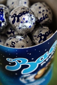 Baci- Perugina Chocolate Kisses with whole hazelnut inside. They have love fortunes as well. The classic, first love.
