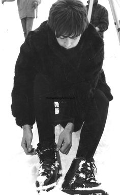 Original photo of Paul McCartney tying his bootlaces on the set of HELP