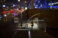A woman walks out of a subway station in the center of Moscow, Russia, Wednesday, Nov. 12, 2014. (AP Photo/Alexander Zemlianichenko)