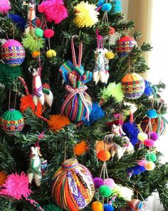 A traditional Christmas tree is the ultimate seasonal decoration. Not only does the presence of a beautifully decorated Christmas tree … Mexican Christmas Decorations, Christmas Tree Themes, Christmas Tree Toppers, Christmas Tree Decorations, Christmas Tree Ornaments, Mexican Christmas Traditions, Bohemian Christmas, Colorful Christmas Tree, Llama Christmas