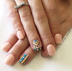 Tribal inspired nude nail art designs. This design proves that you should not be scared in using bold and bright colors together with your all nude nails.
