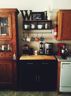 Coffee Bar! That my hubby and I put together. Island/cupboard from Target. Coffee cup shelf from hobby lobby 60% off! Decor and everything else we've accumulated over the years. We love our coffee bar!