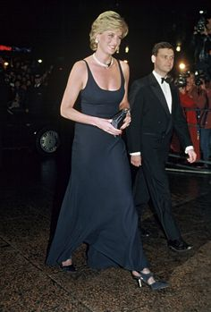 Diana Princess of Wales wearing dark blue Catherine Walker gown and jewellery given by the Sultan of Oman attends the film premiere of the film 'Hot...