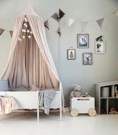 Pretty little girl's room. Linen Canopy and Ooh Noo Toy chest o wheel are all available online.