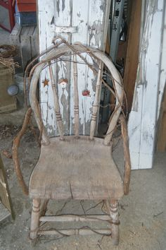 Wonderful old chair with grapevine arms and decorations :)