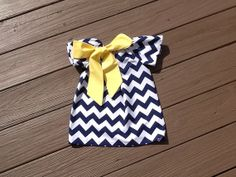 Girls Little Peasant Dress with fabric bow detail. Navy blue or any chevron fabric.  Custom children's clothing. By EverythingSorella