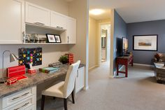 This bonus room is dual purposed.  Home office and entertainment area.  Excel Homes- Kimberley show home, MountainView, Okotoks
