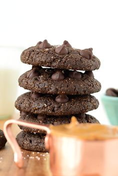 These double chocolate flourless peanut butter cookies are made sans flour, gluten, refined sugar, and butter! They're ooey gooey and taste like a cross between a peanut butter cookie and a brownie!