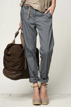 grey slouchy pants with rolled cuffs, neutral heels.
