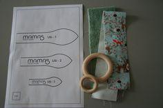 Uši a kroužek - hračka pro miminko