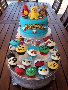 Pokemon cake & cupcakes by Mossy's Masterpiece cake/cupcake designs, via Flickr