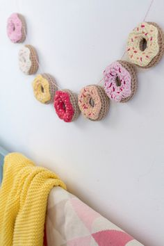 Crochet donut garland with sweet colorful icing and sprinkles. It can be fun and playful nursery or kids room decoration as well as party embellishment. This donut banner can be hung on a childs cot or bed, on the wall, in the window or under the ceiling. Great idea for a themed donut party. Donuts are safe for children and can be also used as toys.  Each donut is made out of 100% cotton yarn with Oeko-Tex® certificate and is filled with certified anti-allergenic polyester fiberfill. Each…