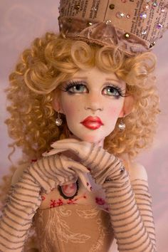 Clothing is removable and is NOT attached. She has sparkling aqua eyes with crystal accents and long wild blonde curly hair styled loosely pulled to the back. She has a full cloth face and body and is all textile and huggable. | eBay!