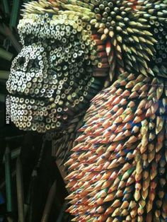 Sculpture of a gorilla made from coloured pencils.