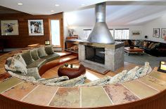 Gather 'round the fireplace with room for friends and family to convene and relax.