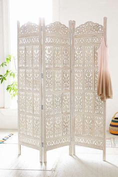 Urban Outfitters Amber Carved Wood Room Divider Screen Intricately carved wooden screen in a tri-fold silhouette. This sturdy standout piece works perfectly as a room divider. Only at Urban Outfitters. Wood Room Divider, Room Divider Screen, Room Divider Headboard, Shabby Chic Room Divider, Room Divider Ideas Bedroom, Headboard Ideas, Bedroom Organization, Bedroom Ideas, Urban Outfitters Home