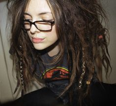 lazy dreads...even though I would never I have them myself, I am still rather fond of this look.  Probably the whole messy hair thing, which I LOVE.