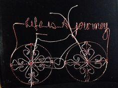 A personal favorite from my Etsy shop https://www.etsy.com/listing/224268420/life-is-a-journey-bicycle-wire-art