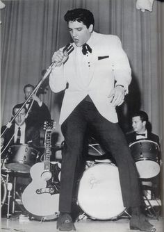 """Elvis performing at the """"Memphis Charity"""" evening show, Feb. 25, 1961. Along with proceeds being disturbed among 26 Memphis charities, $3,789 was raised for the """"Elvis Presley Youth Center"""" in Tupelo."""