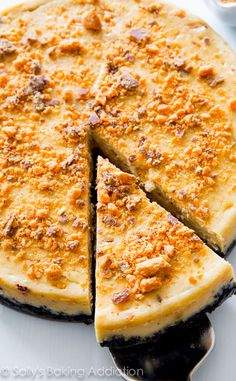 Peanut Butter Butterfinger Cheesecake. This is one incredible indulgent dessert! | sallysbakingaddiction.com | #cheesecake #peanut_butter