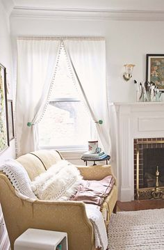 Love this scene. Beautiful curtains. Great color for the love seat. And again, the feathers!