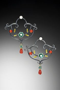 Oxidized sterling and fine silver earrings flow with scrolling, sculptural detail, punctuated with 18k gold vitreous enamel flowers, coral, green topaz, and freshwater pearls. Sterling silver post backs.