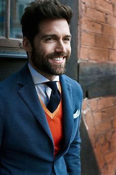 Like the orange v neck with the suit, a difficult look to pull of, few can do it