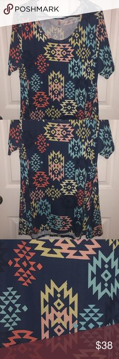 NWOT!! Lularoe Perfect T NWOT!! Somehow the tags got torn off but this top is brand new!  Never washed or worn!! Such a fun print!! LuLaRoe Tops