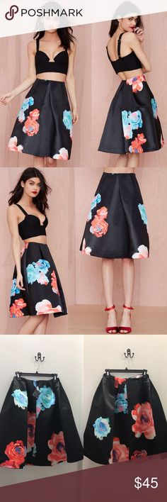 Nasty Gal Bloom and Board Pleated Skirt Get flower powerful. The Bloom and Board Skirt is made in black taffeta and features graphic rose print, pleat detail, and structured silhouette. Blind stitching at hem, back zip closure, unlined. We love it dressed down with a distressed tee and platform combat boots, or dressed up with a mock-neck bodysuit and velvet pumps. By Nasty Gal. *Polyester Brand new boutique item currently selling in my store in Sacramento *Model is wearing smallest size…
