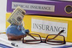 clean insurance form folders pen piggy bank and glasses