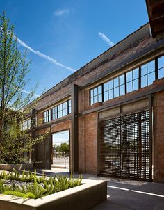 Hughes Warehouse by Overland Partners  - Steel shutters and gates secure wall remnants