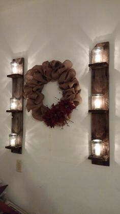 Burlap wreath and mason jar candle sconces