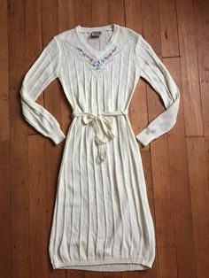 Lovely knit sweater dress with matching belt from the 1970s. Label reads: Skiva.
