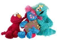 Jesse with Elmo and Rosita