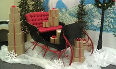 Optrics' restored antique sleigh and decor