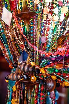 boho bead curtain - I see a beaded mobile - play - inspiration (use the purple moon and stars bead curtain? to make a mobile and a lamp???