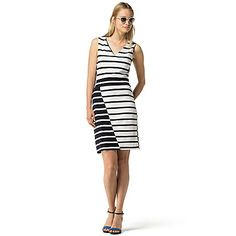 Tommy Hilfiger women's dress. Easy and versatile, this V-neck dress is spun from a soft knit that looks polished and resists wrinkling. A shadow stripe design draws the eye inward and creates a flattering silhouette. <br>•Classic fit.<br>•52% cotton, 42% viscose, 6% polyamide.<br>•Sleeveless, V-neck. <br>•Machine washable.<br>•Imported.<br>