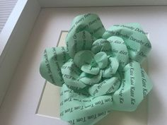 Brand new product from Karolina Rose! Personalised paper roses on coloured paper. Can feature family names or wedding dates. Great gifts for families and weddings too! See more colour choices on our Etsy shop... #WeddingFavours #GiftIdeas #PaperRoses #UniqueGift Framed or Unframed Green Paper Rose