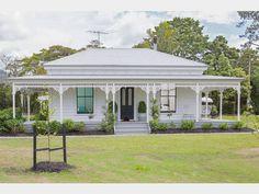 Exterior of beautiful updated white wooden original 3 bedroom 1915 kauri villa @ Matakana Valley Rd, Matakana. With black trim around windows and doors. Classy. (in Nov 2014)