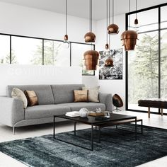 BoConcept living room. Grey sofa, and copper lamp