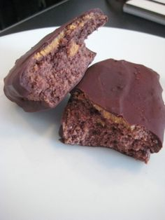 Chocolate Peanut Butter Protein Bars - magic shell chocolate, 1/2C Almomnd Milk, 4tbsp Peanut Butter, 2tbsp Cocoa Powder, 3/4C Coconut Flour, 6.25 scoops Whey Protein Powder. Mix ingredients by hand and freeze until hardened then make magic shell chocolate and dip frozen bars