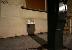 Clever Street Art Depicts Snoopy From 'Peanuts' Sleeping on the Shadow of a Parking Meter