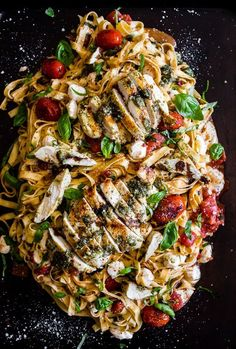 This pesto chicken Caprese pasta is packed full of flavor and packed full of pesto grilled chicken, grape tomatoes, fresh mozzarella and lots of basil.