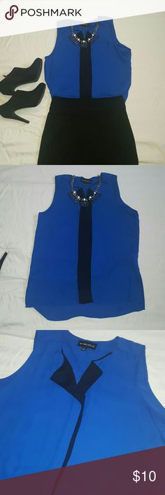 Royal Blue and Black Sheer Top Royal and Black sleeveless top. Open collar with black detail down the front. Looks great tucked in to a pencil skirt or worn out over skinnies. Tops Blouses