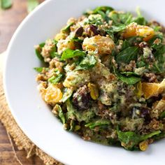 Moroccan Salad with Cilantro Orange Dressing - with dates, pistachios, spinach, bulgur, and the most delicious homemade dressing.