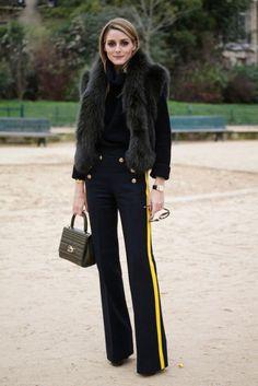 Try a fur vest, sailor pants with a racing stripe, handheld bag, and black turtleneck like OP.
