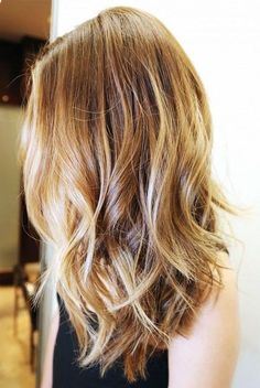 Highlighted messy waves on long hair with slight bob in back