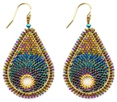 Enchanting, beautiful, and exotic colors make these earrings a must have. Size: 2 inches x 1.25 inches. Not including earwires. Skill Level: Intermediate Technique: Circular Brick Stitch following a p