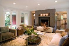 ... fireplace -surround-large-window- modern -armchair- modern - fireplace