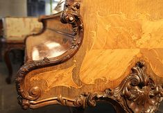 A Rococo Style, Erard Grand Piano For Sale with a Quarter Veneered, French Walnut and Rosewood Case. Cabinet Features Ornately Carved Legs and Cheeks. Beautifully Fine Inlay Adorns All Sides of the Cabinet in a Scrolling Floral Design. A Stunning Example of a Rococo Style Piano at Besbrode Pianos.